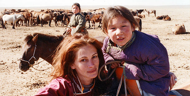 Julia Roberts with Mongolian girl and their wild horses.