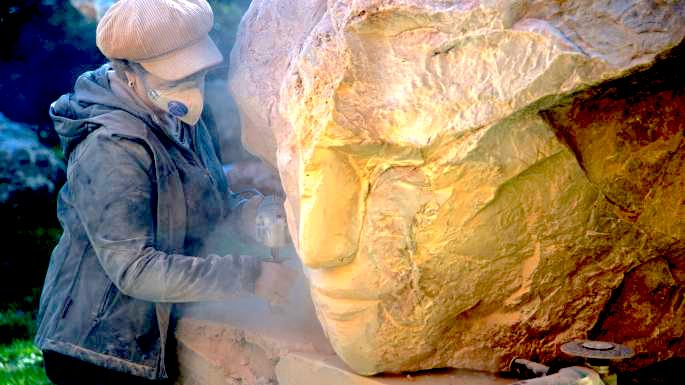 Emily Young working on one of the 10-ton marble heads to be thrown into the Mediterranean to save the fish. Photo: Emily Young (believed)