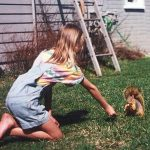 Michelle when young feeding a squirrel