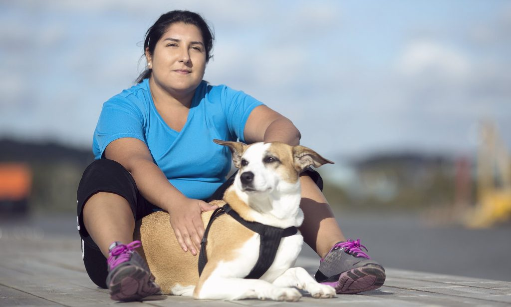 Overweight person with overweight dog