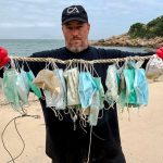 Gary Stokes, co-founder of marine conservation group OceansAsia, shown holding up the coronavirus facemasks that he recovered from a Hong Kong beach