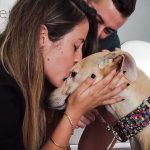Loving kiss for scared but rehabilitated dog
