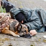 Homeless person and dog
